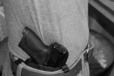 Perhaps as important, or more important, than the gun itself, is the holster holding the gun. Holsters completely dictate how comfortable, concealable, and accessible a handgun will be. Holsters are either made out of leather or kydex/injection molded polymer. Leather is the most pliable and comfortable, but also holds moisture and eventually will lose its shape. Polymer is more durable, repels moisture, retains its shape forever, and has the smoothest draw stroke. Its rigid nature can be uncomfortable if formed or worn improperly and some common kydex rigs are more bulky than comparable leather holsters. There are also hybrid holsters that use both materials. All holsters will wear on a pistol's finish. Any gun that spends any significant amount of time in a holster will show wear…best make peace with it up front. Daily carry holsters come in many shapes, sizes and configurations, but most fit into one of two categories. Inside the waistband (IWB), and outside the waistband (OWB). Read more...